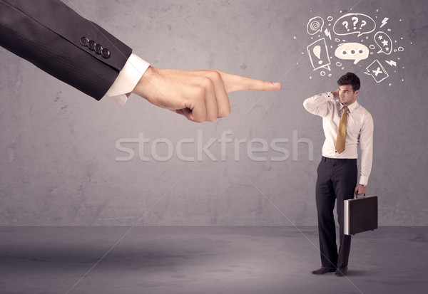 Boss hand pointing at confused employee Stock photo © ra2studio