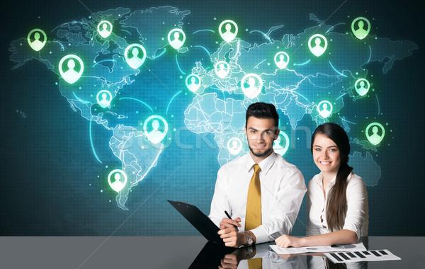 Business paar social media verbinding vergadering tabel Stockfoto © ra2studio