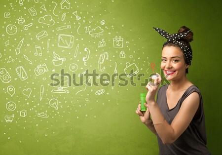 Gyönyörű nő fúj szappanbuborék copy space zöld lány Stock fotó © ra2studio