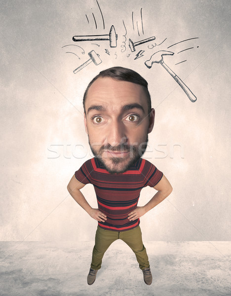 Big head person with drawn hammers Stock photo © ra2studio