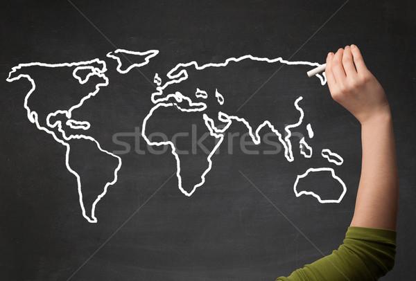 Adult drawing world map on chalkboard Stock photo © ra2studio