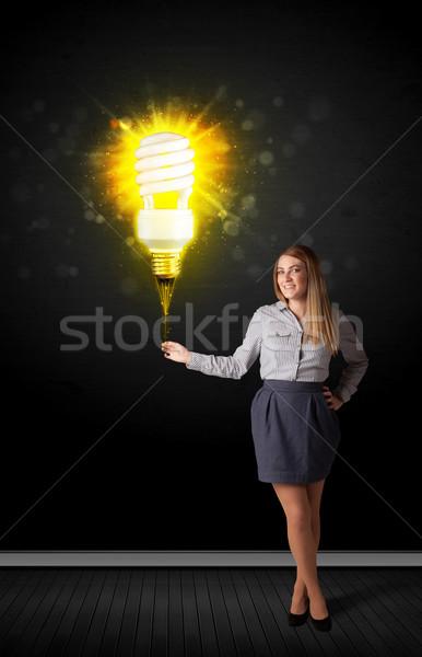 деловая женщина лампа Идея черный Сток-фото © ra2studio