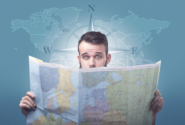 Young man holding map Stock photo © ra2studio
