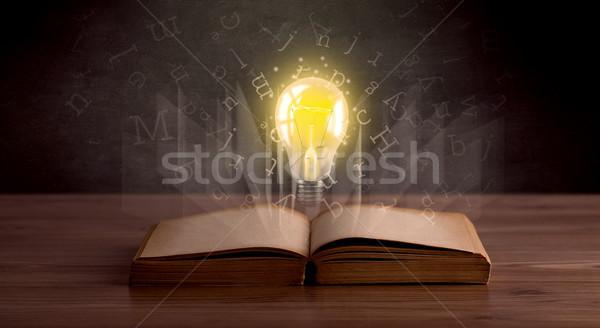 Letters and lightbulb over book  Stock photo © ra2studio