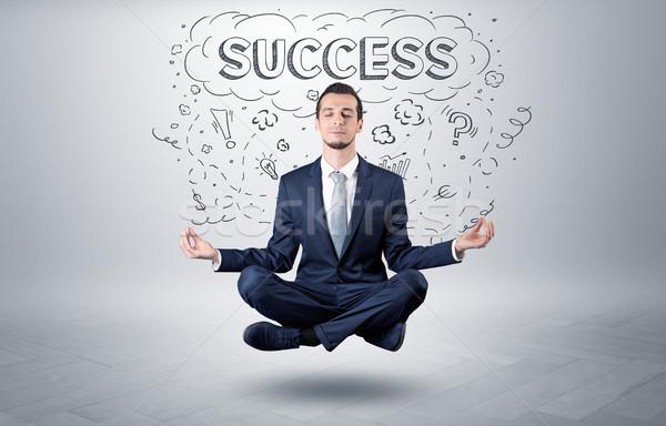 Businessman meditates with doodle concept Stock photo © ra2studio