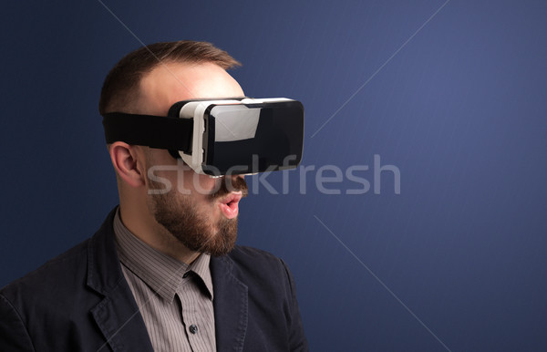Businessman with virtual reality goggles Stock photo © ra2studio