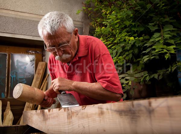 Dolgozik véső öreg kéz fa építkezés Stock fotó © ra2studio