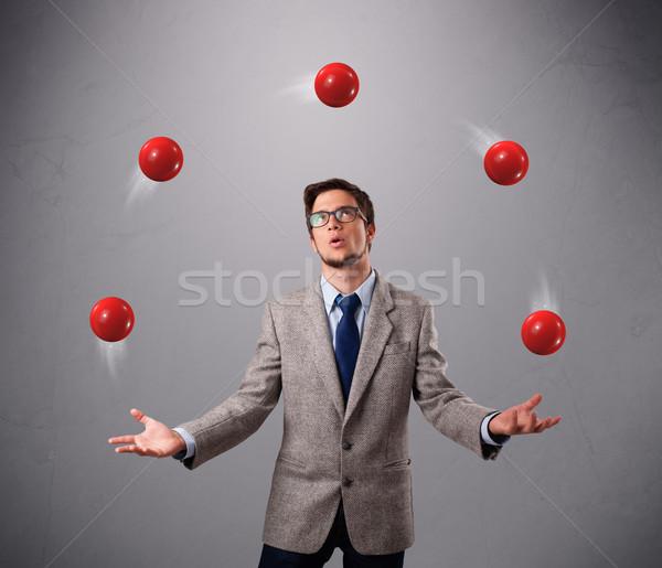 Jonge man permanente jongleren Rood knap Stockfoto © ra2studio