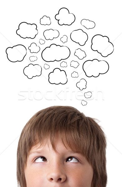 Young head thinking with clouds Stock photo © ra2studio
