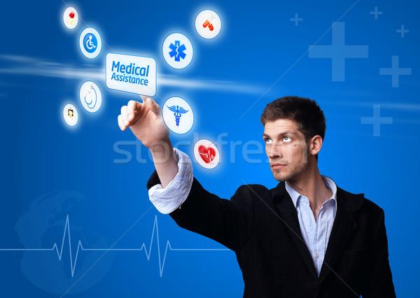 doctor pressing digital button Stock photo © ra2studio