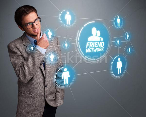 Yakışıklı adam bakıyor modern sosyal ağ yakışıklı genç Stok fotoğraf © ra2studio