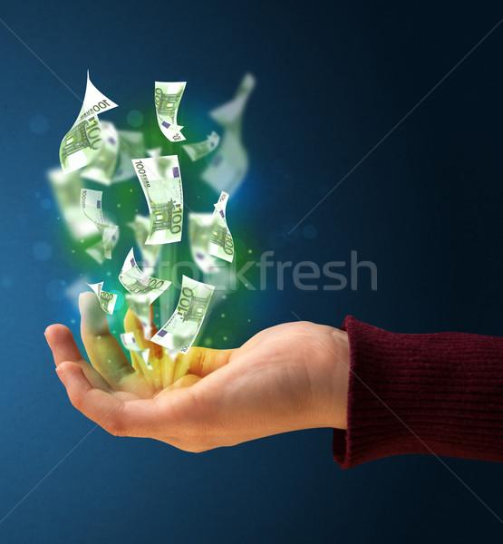 Izzó pénz kéz nő tart papír Stock fotó © ra2studio