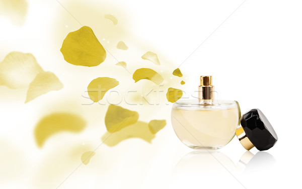 Fles rozenblaadjes parfum kleurrijk blad schoonheid Stockfoto © ra2studio