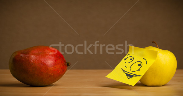 Apple with post-it note looking curiously at mango Stock photo © ra2studio