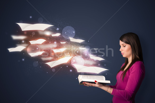 Young lady reading a book with flying sheets coming out of the b Stock photo © ra2studio