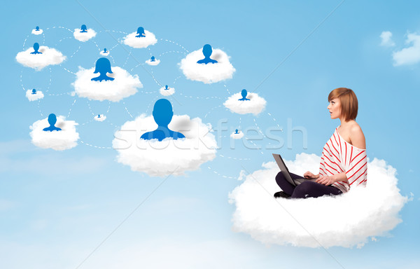 Genç kadın oturma bulut dizüstü bilgisayar güzel sosyal ağ Stok fotoğraf © ra2studio