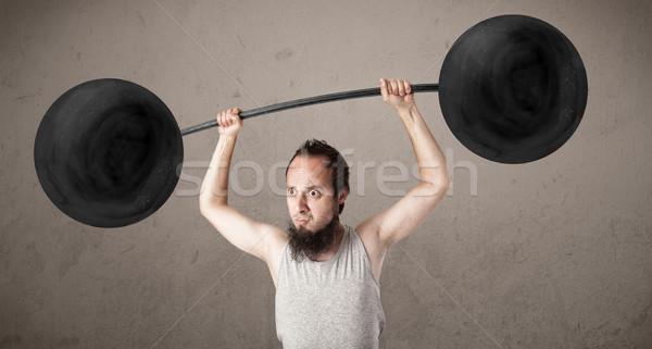 Vicces sovány fickó emel súlyok hihetetlen Stock fotó © ra2studio