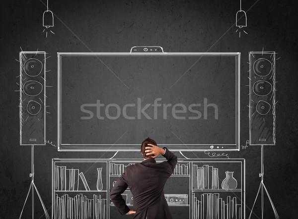 Zakenman home cinema jonge permanente genieten man Stockfoto © ra2studio