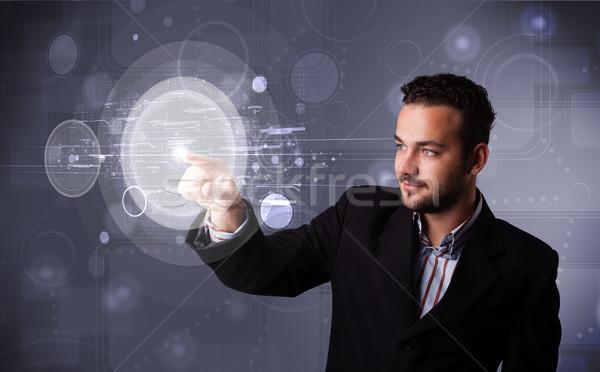 Attrattivo imprenditore toccare abstract alta tecnologia giovani Foto d'archivio © ra2studio