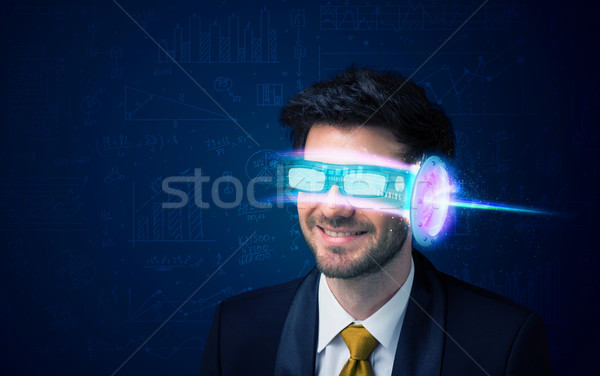 Stock photo: Man from future with high tech smartphone glasses