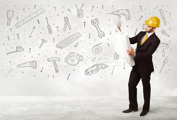 Travailleur de la construction dessinés à la main outil icônes affaires homme Photo stock © ra2studio