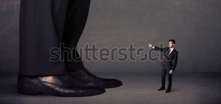Hatalmas láb pici férfi háttér öltöny Stock fotó © ra2studio
