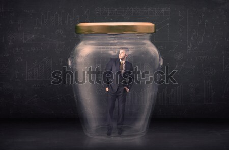 Business man closed into a glass jar concept Stock photo © ra2studio