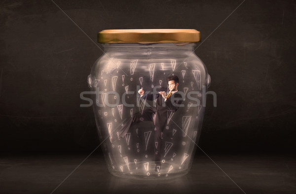 Business man trapped in jar with exclamation marks concept Stock photo © ra2studio