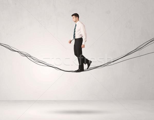Verkoop persoon balancing touwen zakenman Stockfoto © ra2studio