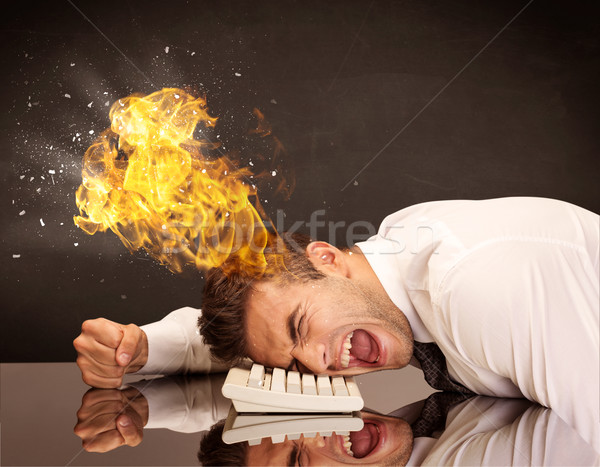 Stressed business man's head is burning Stock photo © ra2studio