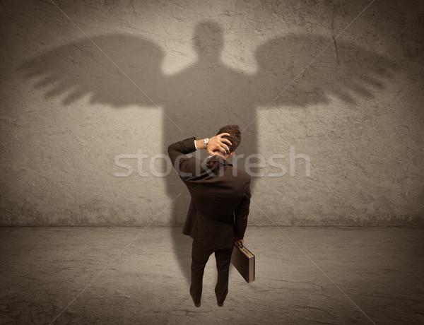 Tisztességes eladó angyal árnyék sikeres üzletember Stock fotó © ra2studio