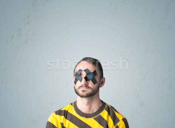 Young man with glued eye Stock photo © ra2studio