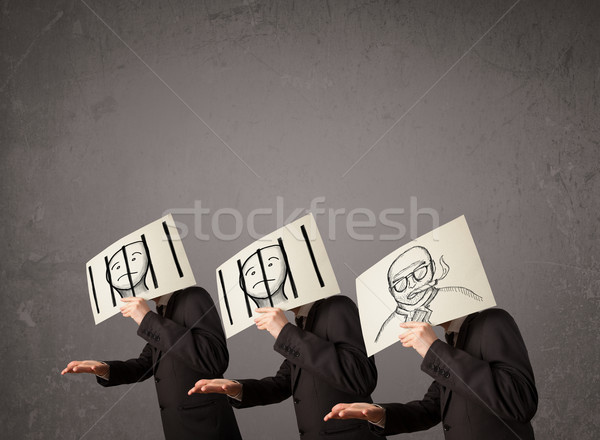 Men in formal gesturing with cardboard in front of their head Stock photo © ra2studio