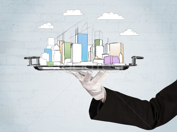 Hand serving city and clouds on tray Stock photo © ra2studio