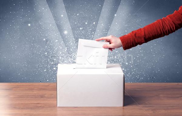 Ballot box with person casting vote Stock photo © ra2studio