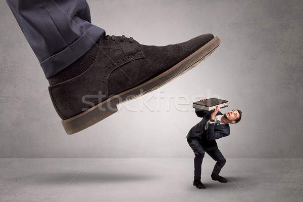 Small man trampled by the great power Stock photo © ra2studio