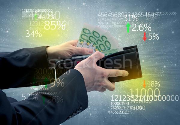 Biznesmen strony na zewnątrz euro portfela giełdzie Zdjęcia stock © ra2studio