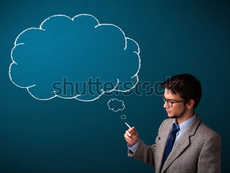 Young man smoking cigarette with idea cloud Stock photo © ra2studio