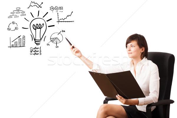 Jeunes femme d'affaires ampoule diagrammes Photo stock © ra2studio