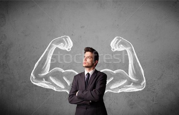 Businessman with strong muscled arms Stock photo © ra2studio