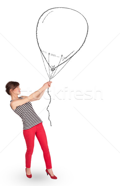 Stock photo: Pretty woman holding balloon drawing