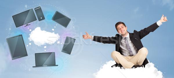 Heureux jeunes affaires séance nuage Photo stock © ra2studio