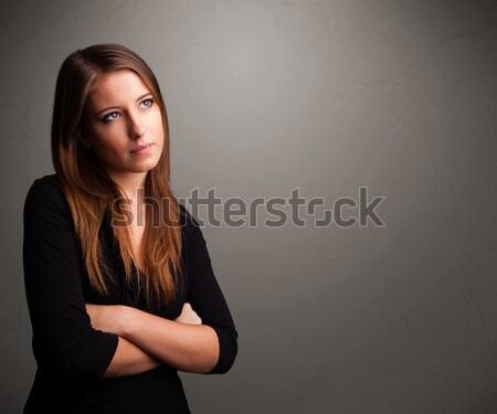 Beautiful woman thinking with empty copy space Stock photo © ra2studio