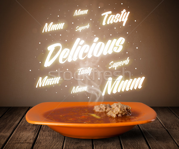 Soup with delicious and tasty glowing writings Stock photo © ra2studio