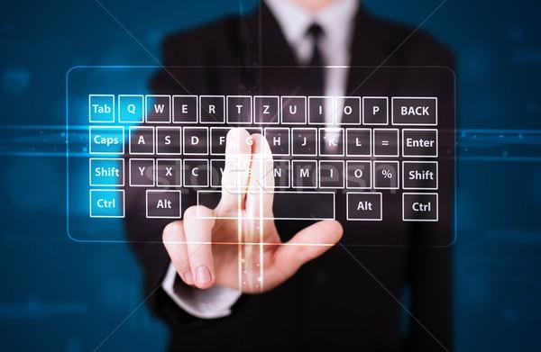 Businessman pressing virtual type of keyboard Stock photo © ra2studio