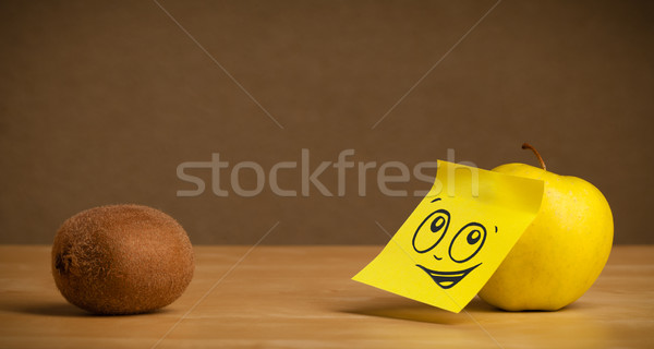 Apple with post-it note looking at kiwi Stock photo © ra2studio