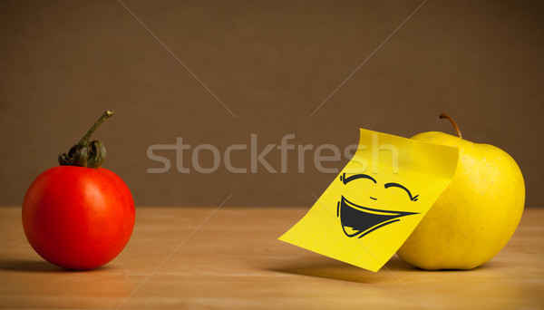 Stock photo: Apple with post-it note laughing on tomato