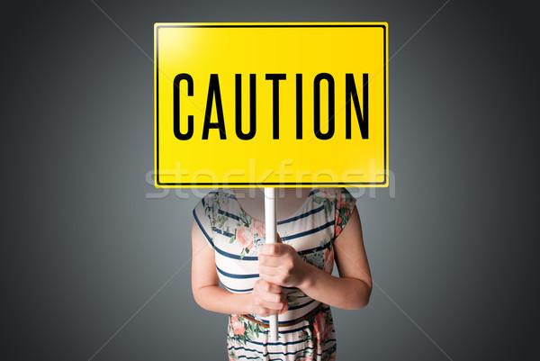 Młoda kobieta ostrożność podpisania młodych pani Zdjęcia stock © ra2studio