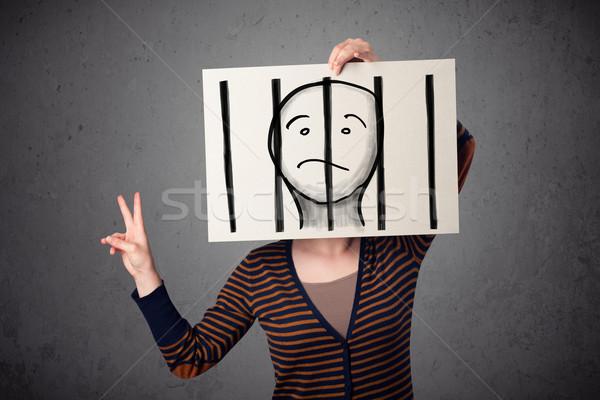Nő tart papír fogoly mögött rácsok Stock fotó © ra2studio