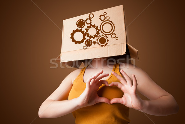 Fiatal nő gesztikulál kartondoboz fej áll nő Stock fotó © ra2studio